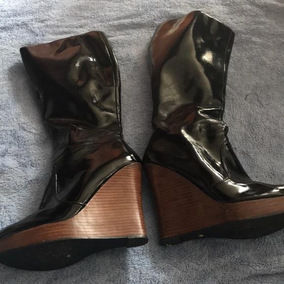 4a3e9f889a1b Victoria Secret Wedge heel zip up boots. M 5b0add789d20f08f6cd8eb88